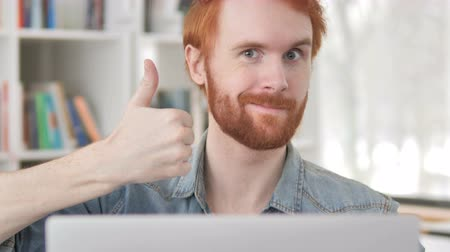polegar : Thumbs Up by Casual Redhead Man at Work