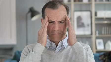 disturbed : Headache, Portrait of Tense Middle Aged Man in Office Stock Footage