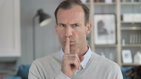 kept : Silent, Silence Gesture by Middle Aged Man