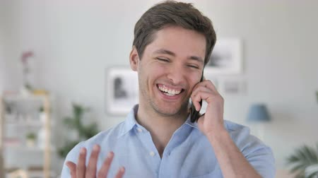 discar : Handsome Young Man Talking on Phone