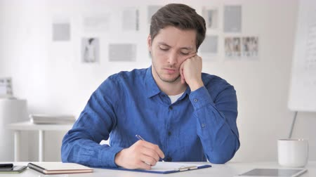 документация : Pensive Casual Adult Man Writing an Article