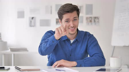 invite : Casual Adult Man Pointing with Finger toward Camera