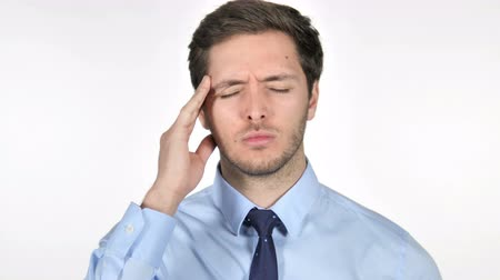 obličejový : Stressed Young Businessman with Headache on White Background