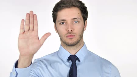 связать : Stop Gesture by Young Businessman on White Background
