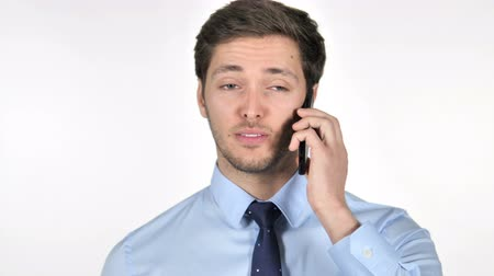 議論 : Young Businessman Talking on Phone