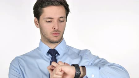 e mail address : Young Businessman Using Smartwatch on White Background Stock Footage