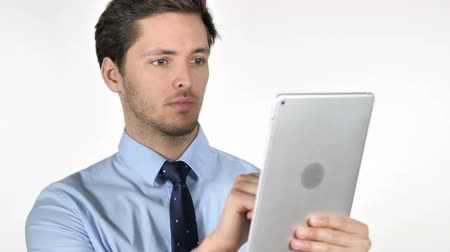 住所 : Young Businessman Using Tablet on White Background