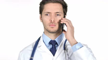 discar : Young Doctor Talking on Smartphone, White Background