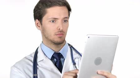 страница : Young Doctor Using Tablet on White Background