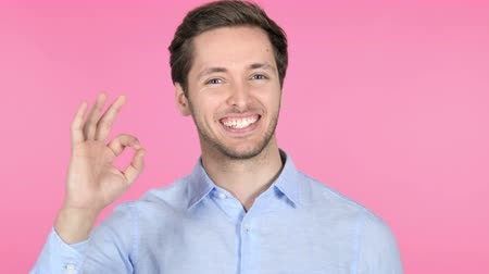 obličejový : Gesture of Okay by Young Man on Pink Background Dostupné videozáznamy