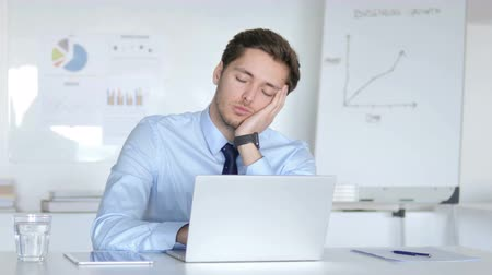 kabine : Tired Young Businessman Sleeping at Work Stok Video
