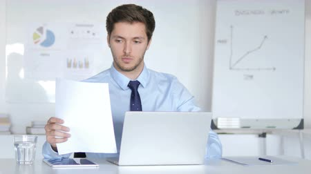 подпись : Young Businessman Working on Contract, Paperwork