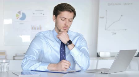 kabine : Thoughtful Businessman Writing in Office