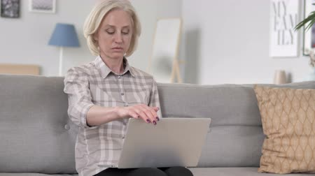 hurry up : Old Woman Leaving after Closing Laptop Stock Footage
