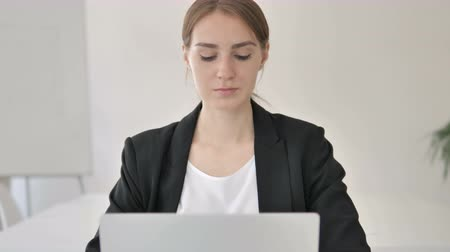 use laptop : Close Up of Young Businesswoman Typing on Laptop