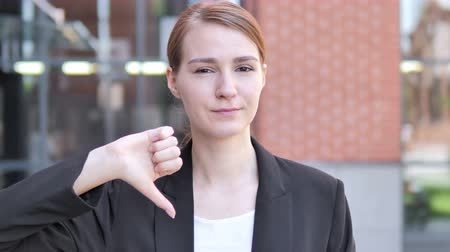 unsuccessful : Thumbs Down by Young Businesswoman, Outdoor