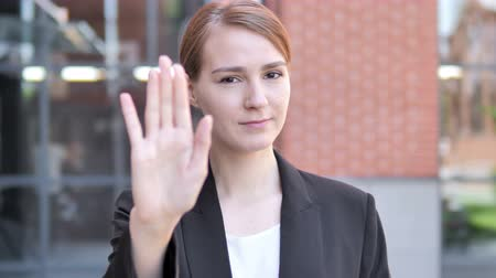 stopping : Stop Gesture by Young Businesswoman, Outdoor