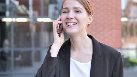 discar : Young Businesswoman Talking on Phone Outdoor Stock Footage