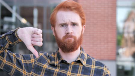unsuccessful : Thumbs Down by Redhead Beard Young Man, Outdoor