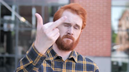 abuso : Redhead Beard Young Man Showing Middle Finger Stock Footage