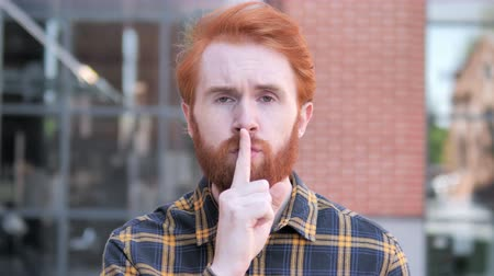 rejeitar : Silence Please, Finger on Lips by Redhead Beard Young Man Stock Footage