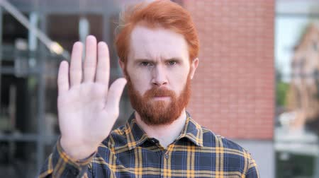 stopping : No, Stop Gesture by Redhead Beard Young Man Stock Footage