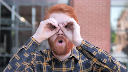invite : Binocular Gesture by Redhead Beard Young Man Stock Footage