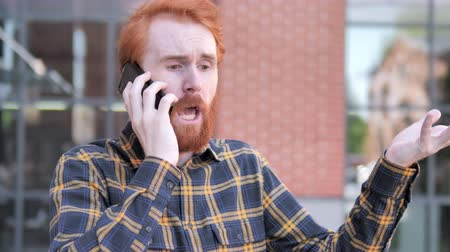 discar : Angry Redhead Beard Young Man Talking on Phone