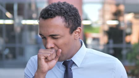 coughing : Sick African Businessman Coughing Outdoor Stock Footage