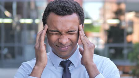 tense : Headache, Uncomfortable Stressed African Businessman Stock Footage