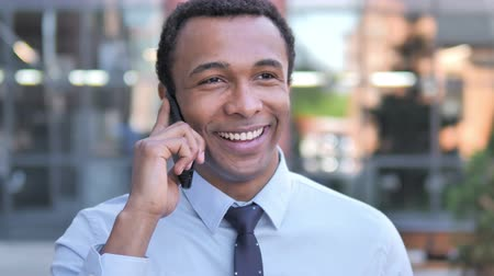 discar : African Businessman Talking on Phone Outdoor Stock Footage