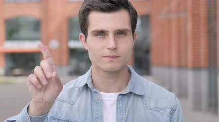 değil : Rejecting Young Man Waving Finger, Outdoor Stok Video