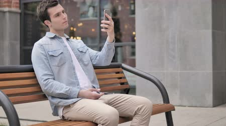 discar : Young Man Taking Selfie on Phone