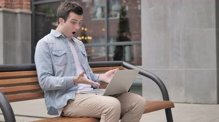 desperate student : Man Frustrated by Results, Sitting Outside Office