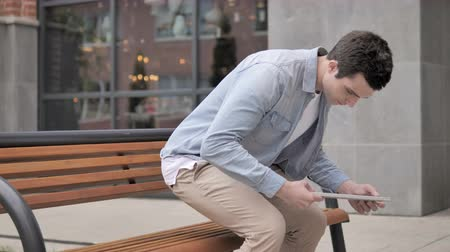 coming home : Young Man Coming, Sitting on a Bench and Opening Laptop Stock Footage