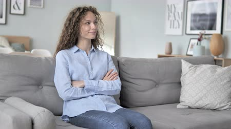 megvitatása : Curly Hair Woman Sitting on Couch at Home