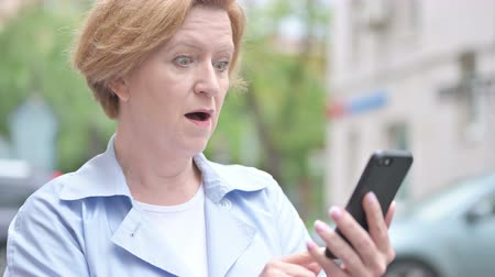e mail address : Woman Using Smartphone Stock Footage