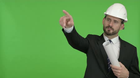 señalando : Engineer with Blueprint pointing with Finger against Chroma Key Archivo de Video
