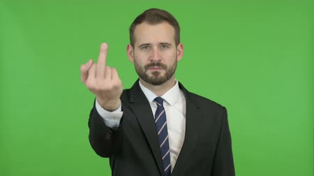 gritar : Handsome Businessman Showing off Middle Finger against Chroma Key Vídeos