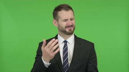 gritar : Ambitious Businessman getting Upset against Chroma Key