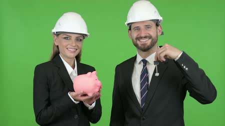 копилку : Engineers Posing with Piggy Bank and Construction Equipment Against Chroma Key