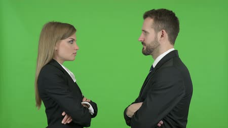 merging : Young Male and Female Professionals Standing and Staring at each other against Chroma Key
