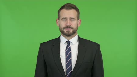 derrota : Stressed Businessman looking Upset against Chroma Key