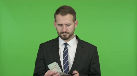 кошелек : Young Businessman Showing off Money from Wallet against Chroma key