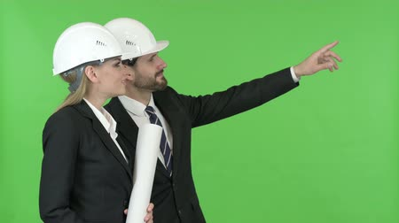 merging : Happy Engineers Looking at Construction work Against Chroma Key Stock Footage