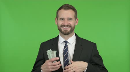 miktar : Businessman putting Money in pocket with Thumbs UP against Chroma Key Stok Video