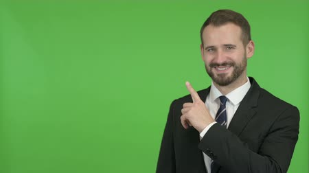 hand sign : Young Businessman pointing with Finger without against Chroma Key