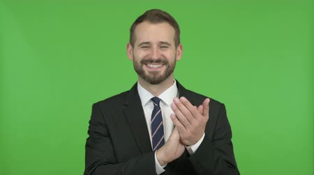 webpage : Cheerful Businessman clapping with both hands against Chroma Key
