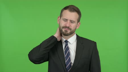 ortopedia : Tired Young Businessman having Neck pain against Chroma Key