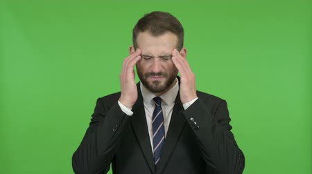 cansado : Tired Young Businessman having Headache against Chroma Key Stock Footage